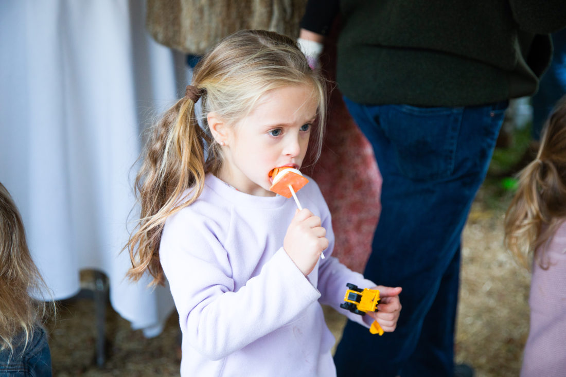 Marlowe Martino enjoys a traffic cone shaped cake pop at brother Major's Construction Zone themed birthday party