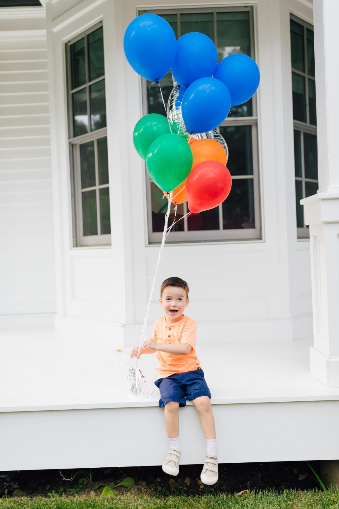 Eva Amurri Martino's son Major holds a handful of balloons for his 3rd birthday