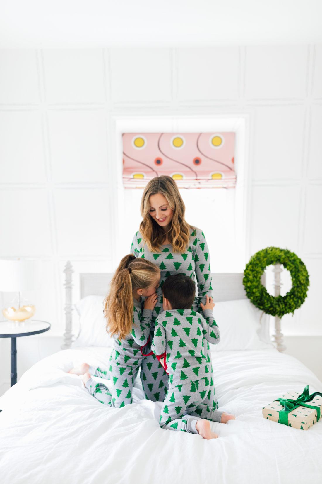 Marlowe Martino kisses mother Eva's baby bump wearing matching holiday pajamas