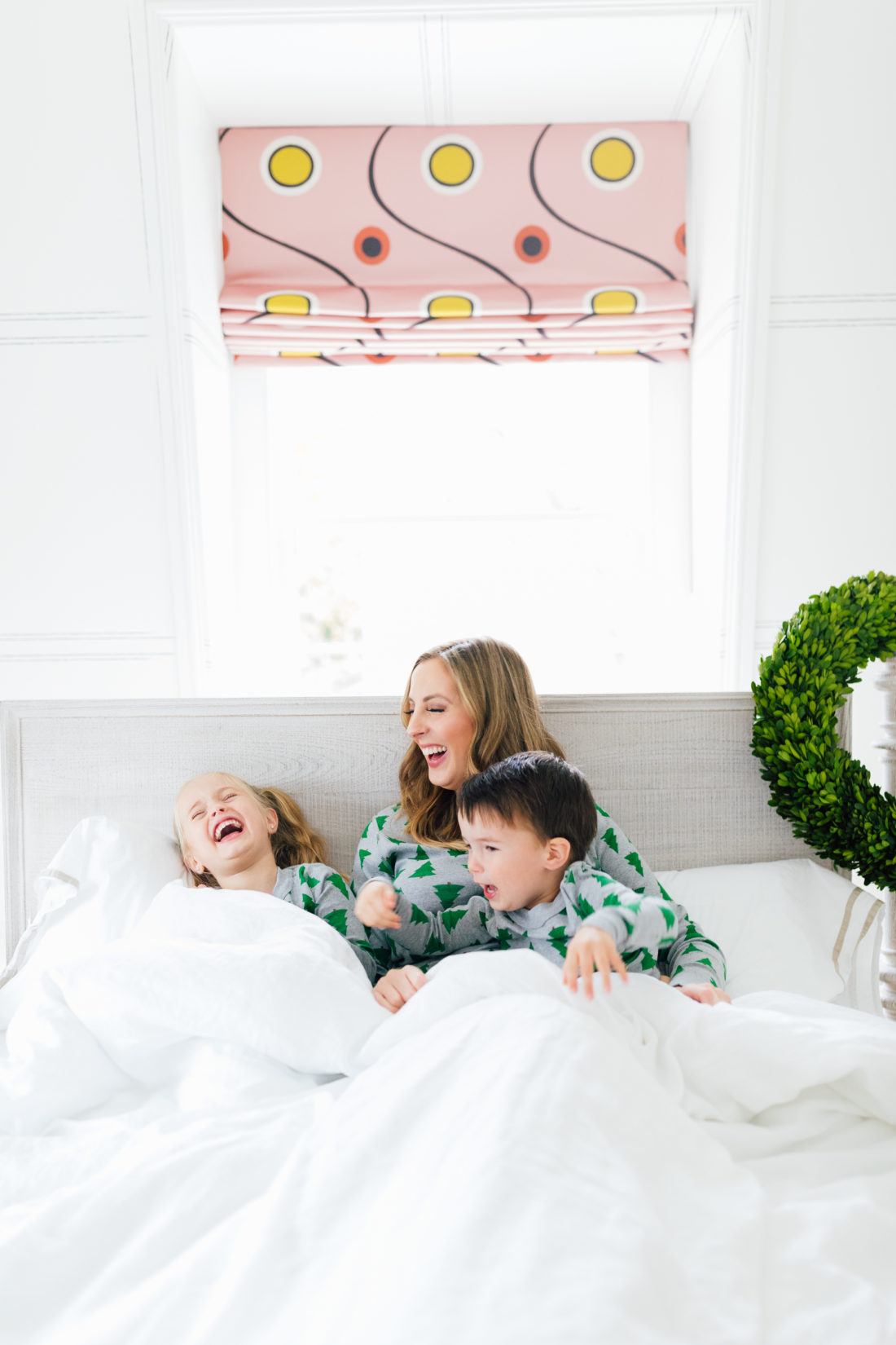 Eva Amurri Martino cuddles with her kids in bed wearing matching holiday pajamas