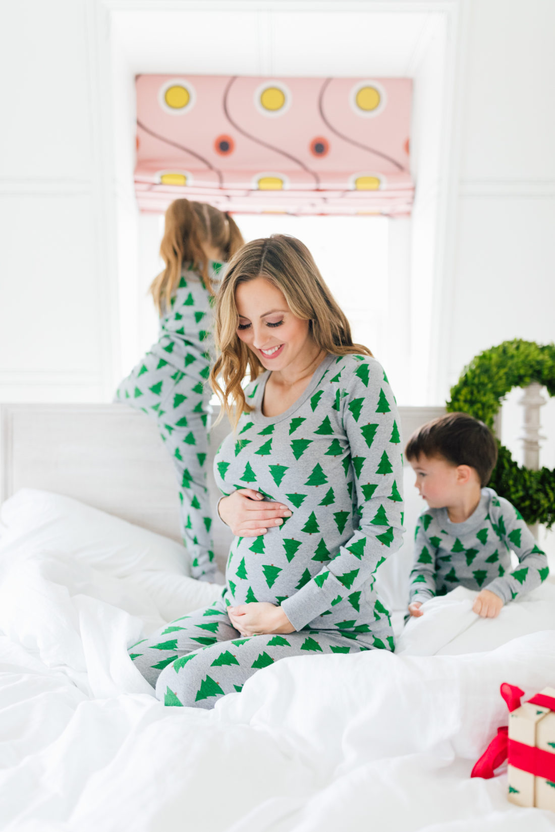Eva Amurri Martino cradles her baby bump in matching holiday pajamas with her kids