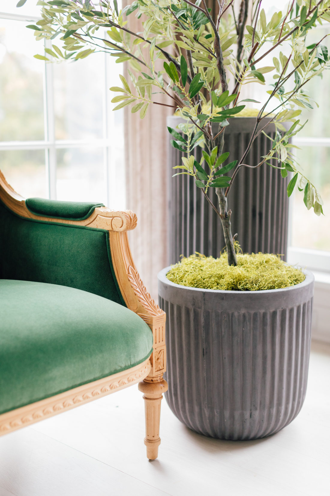 A closeup of the Taylor Burke settee and planters in Eva Amurri Martino's newly renovated Connecticut home