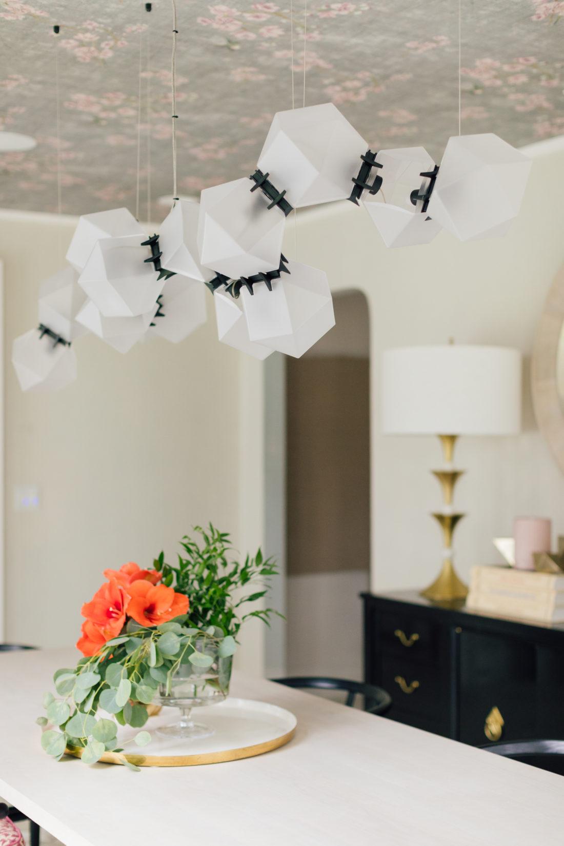 A closeup of the custom Gabriel Scott Chandelier in Eva Amurri Martino's newly renovated dining room