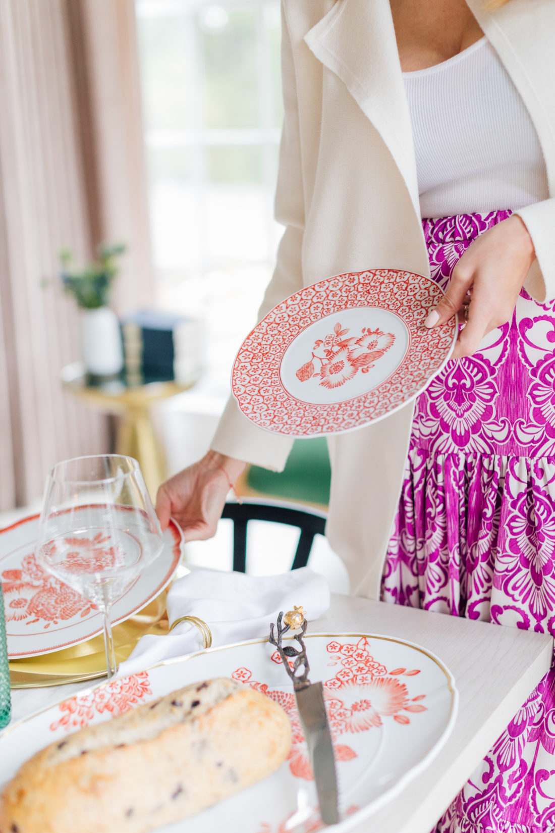 Eva Amurri Martino admires the Oscar de la Renta Coralina China pattern that's part of her 2019 Thanksgiving Decor