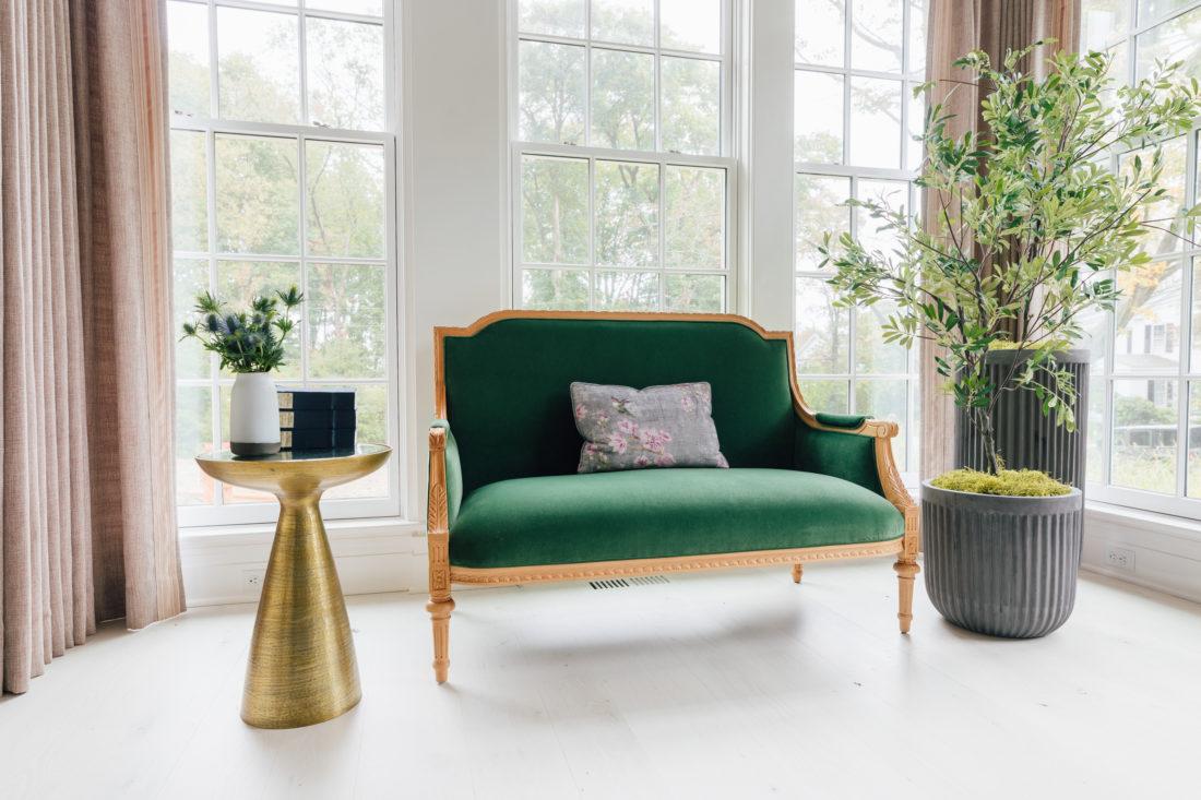 A performance velvet custom settee from Taylor Burke Home inside Eva Amurri Martino's renovated dining room