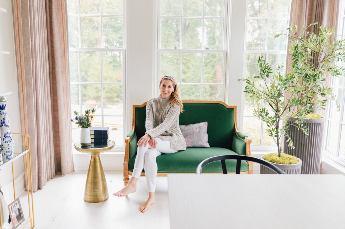 Eva Amurri Martino sits on her custom Taylor Burke settee in her newly renovated dining room