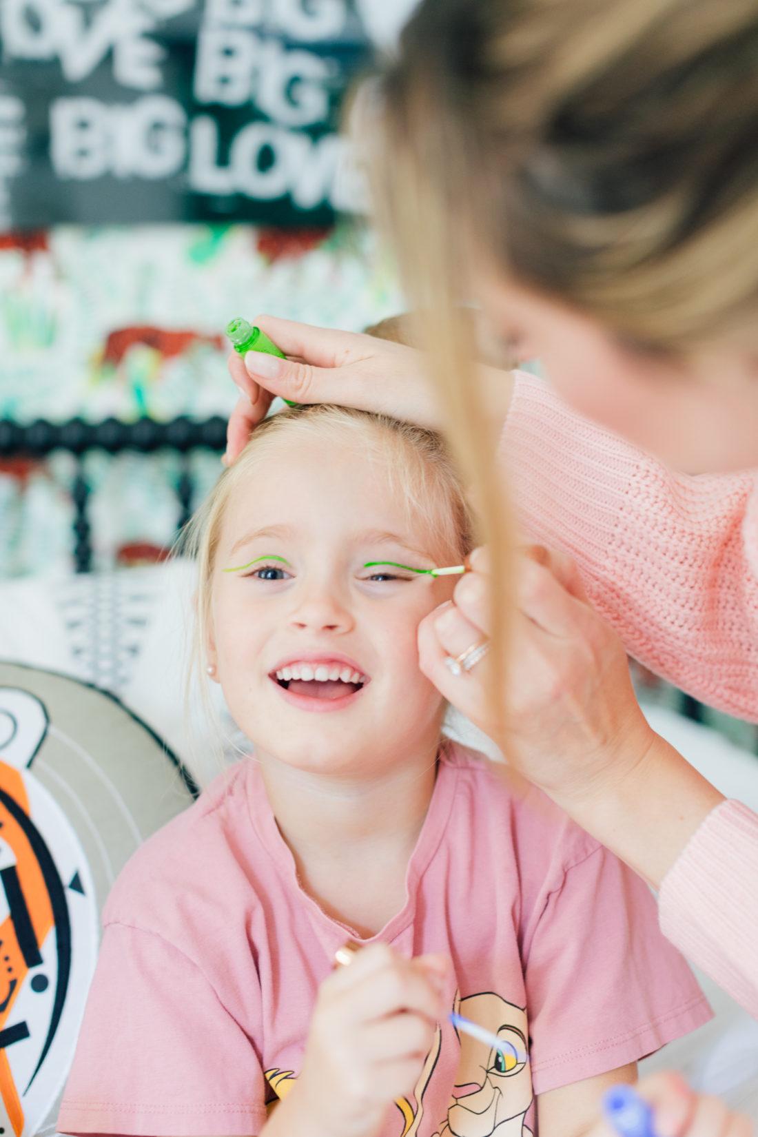 Eva Amurri Martino paints some neon eyeliner on daughter Marlowe