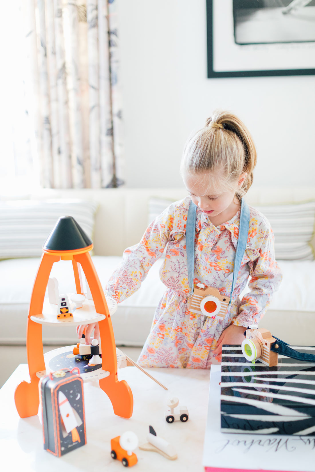 Marlowe Martino plays with a wooden toy from Verishop