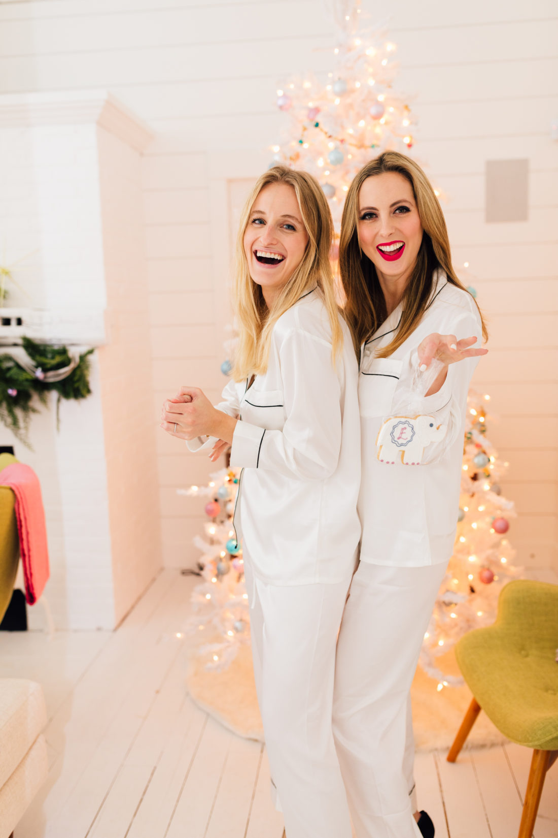Bloggers Eva Amurri and Stephanie Trotta pose in their matching silk pajamas