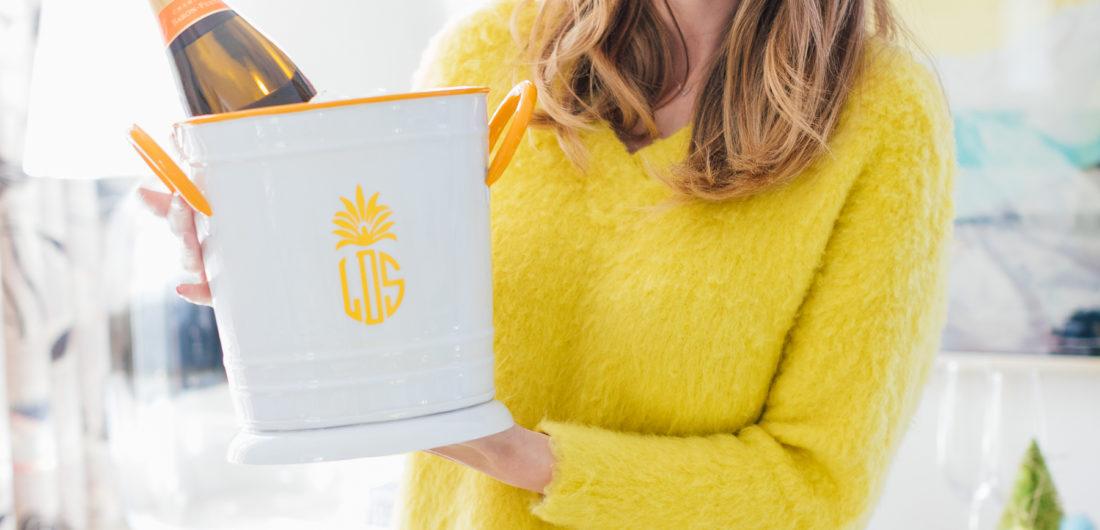 Eva Amurri Martino holds one of her favorite hostess gifts under $50: a Monogrammed Mark & Graham Enamel Ice Bucket