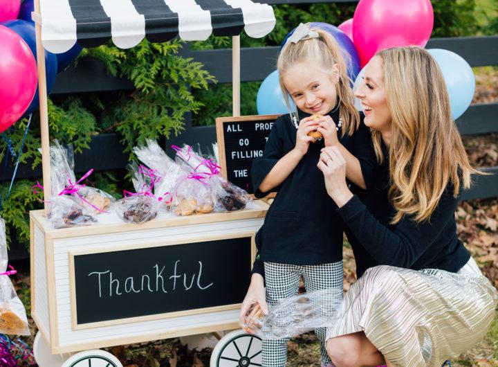 Eva Amurri Martino hugs daughter Marlowe at their bake sale benefitting nonprofit organization Filling in the Blanks