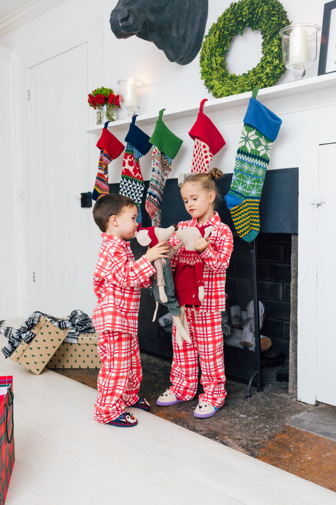 Marlowe and Major Martino show off their matching pajamas in front of their Christmas stockings, all from Garnet Hill