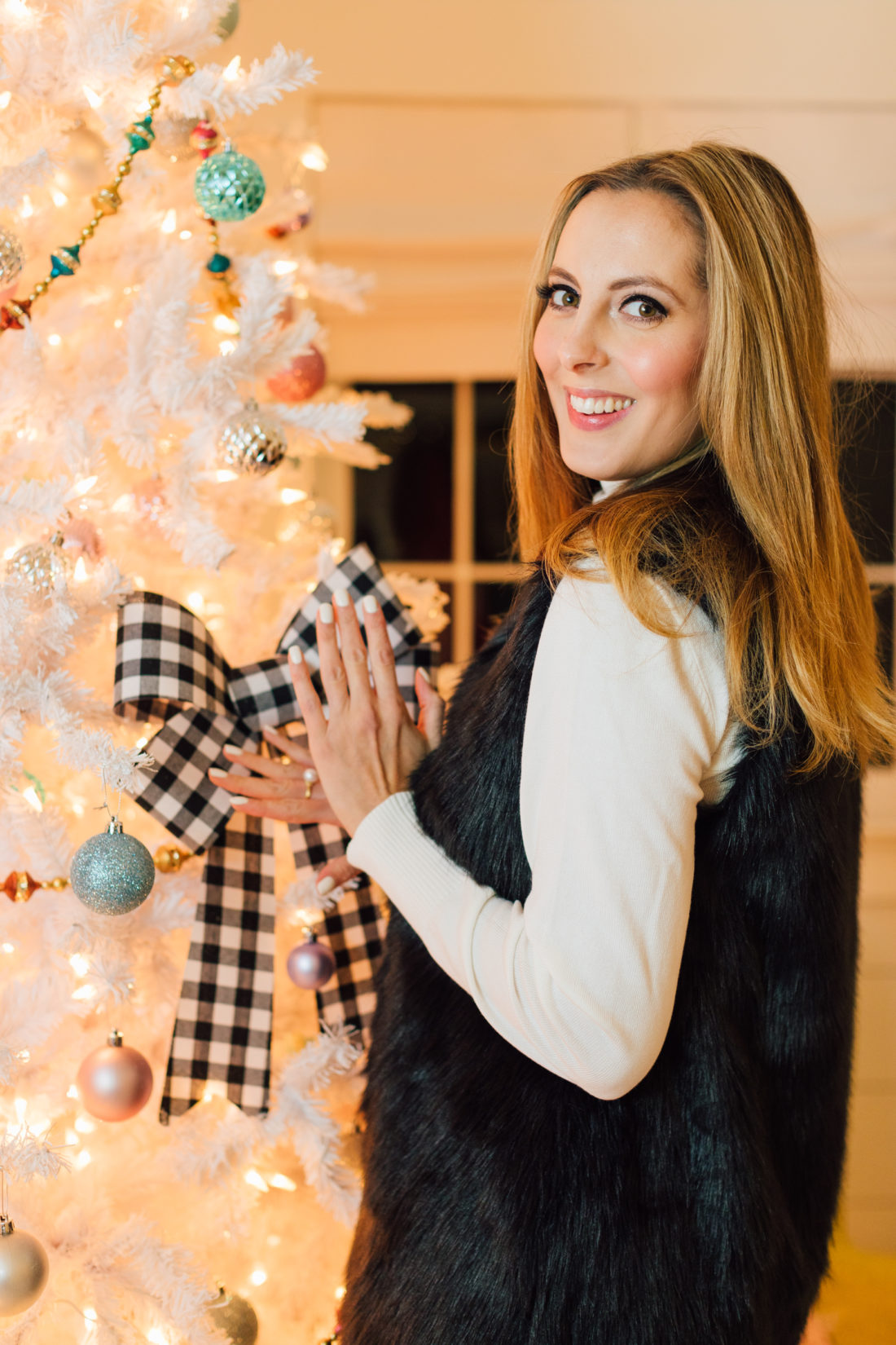 Eva Amurri poses by her Christmas Tree with some products bought at Walmart