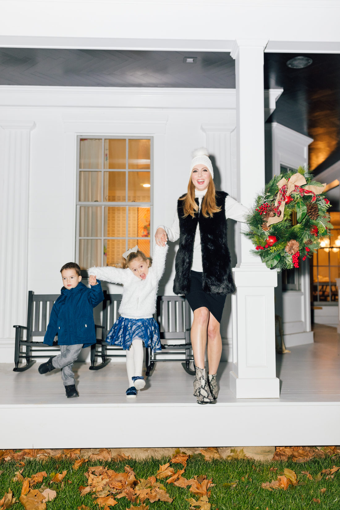 Eva Amurri and kids Marlowe and Major get ready to hang their Christmas Wreath from Walmart
