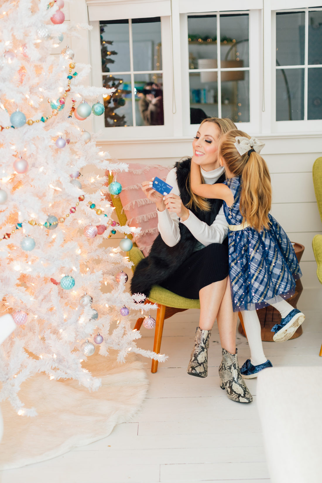Eva Amurri holds her Capital One Walmart Rewards Credit Card by her Christmas Tree