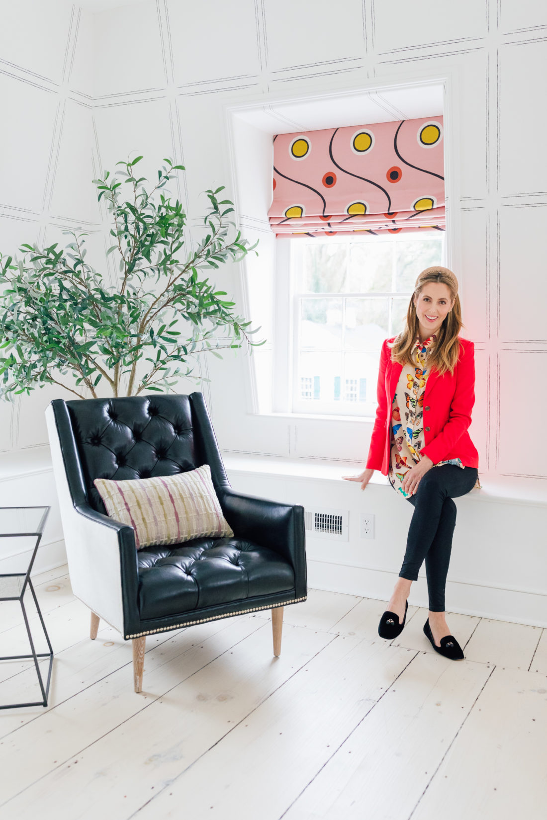 Eva Amurri sits next to a leather chair inside her newly finished Guest Suite