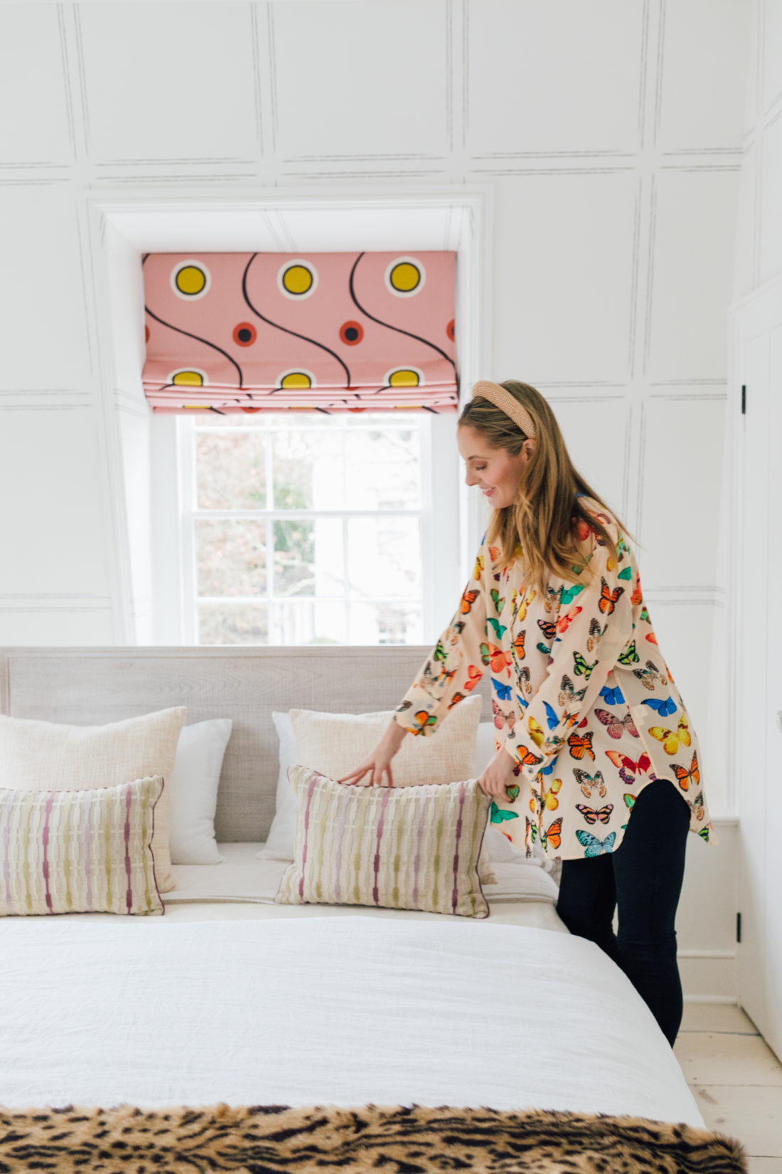 Eva Amurri plumps pillows inside her newly renovated Guest Suite