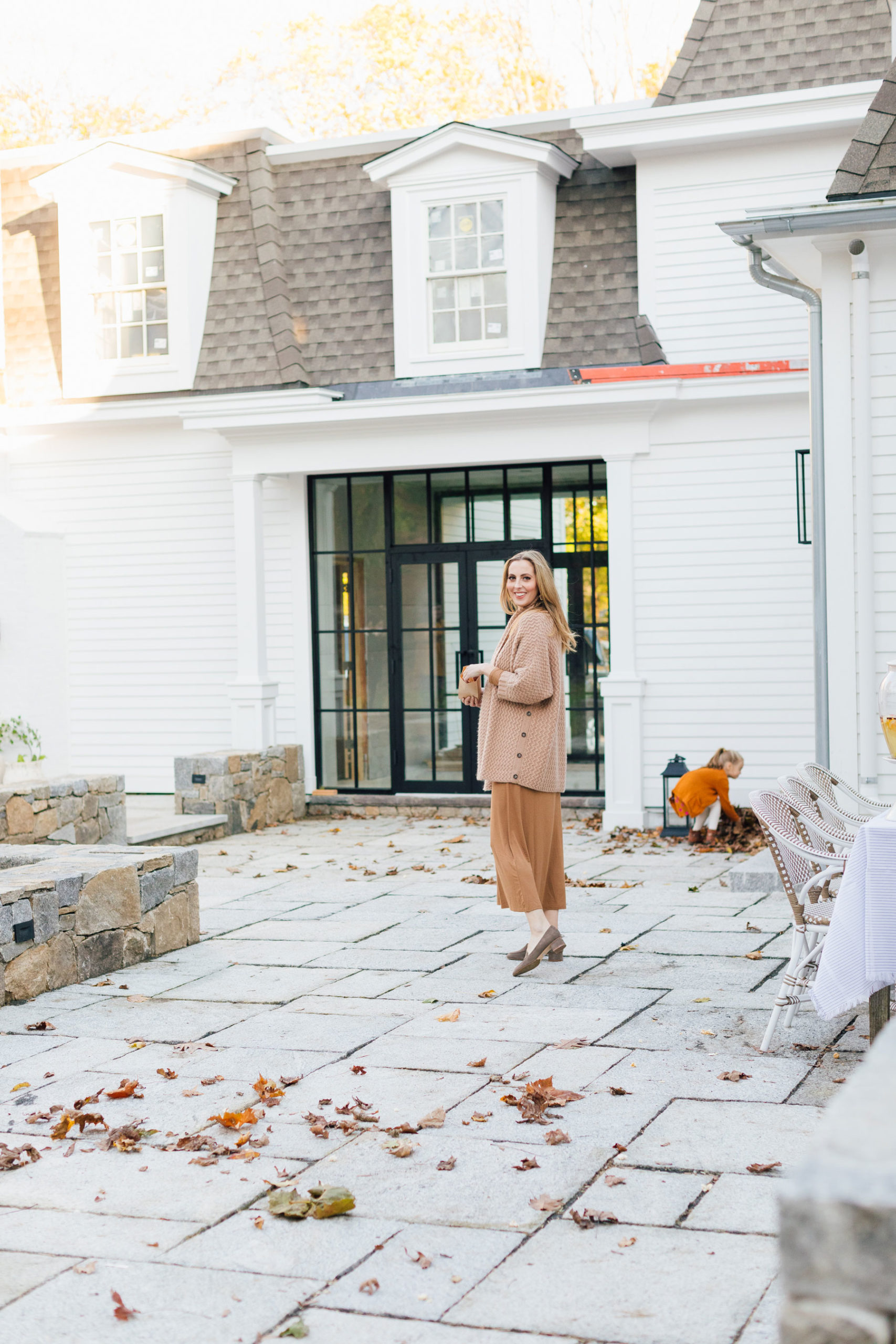 Eva Amurri prepares for an outdoor movie night on the back patio of her Connecticut home