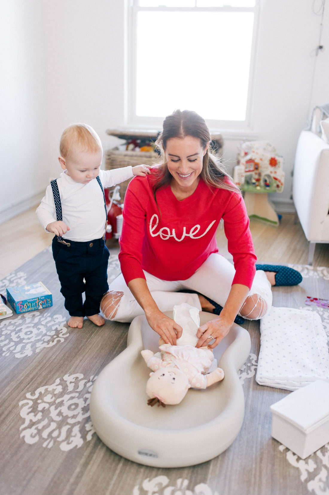 "Blogger Liz Ariola ""Mrs. Nipple"" changes a diaper on a babydoll"